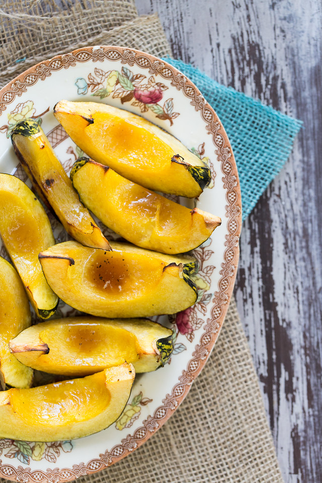 Acorn squash is brushed with a rich and buttery bourbon maple glaze for these sweet and simple Bourbon Maple Grilled Acorn Squash.  If you're grilling your main dish, you might as well grill your side dish!