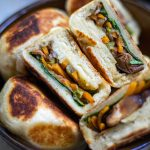 Are you tired of Chinese takeout taking forever to arrive? Then try this Easy Vegan Chinese Pan-Fried Vegetable Buns recipe. Not only does it taste amazing, but it only takes 30 minutes from start to finish. That delivery driver will still be looking for your house while you're busy enjoying these tasty buns! #manthatlooksgood #vegan #veganrecipe #recipe #Chinesefood #vegetablebunsrecipe #chineserecipe