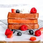 If you're on a keto diet and missing french toast, this easy Keto French Toast Recipe is going to change your life. #manthatlooksgood #frenchtoast #breakfast #keto #ketodiet