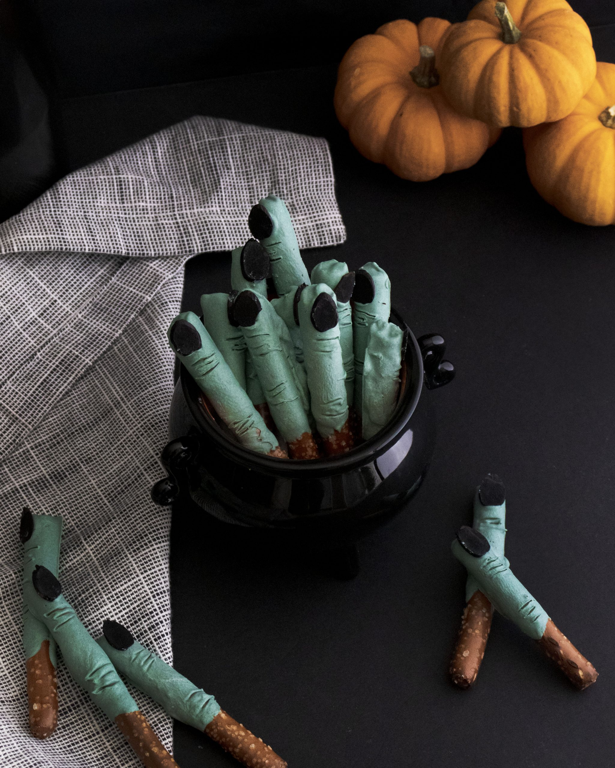 Planning a Halloween get together or just looking for a spooky Halloween snack for the kids? Check out these Creepy Witch Finger Pretzel Sticks. You'll love making them just as much as you love eating them. #halloween #halloweenrecipe #halloweenfood #witch #halloweenparty #witchfingers