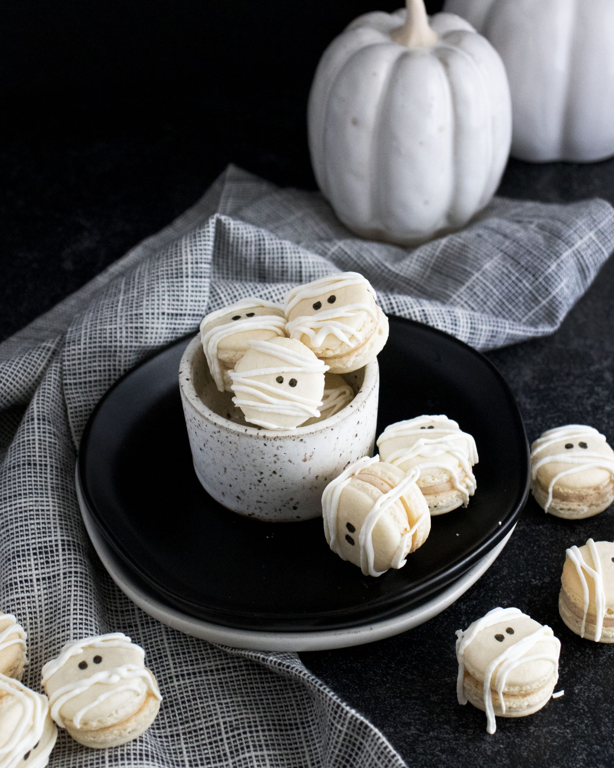 Macarons are really fun to make once you get the hang of them. If you're looking for a fun Halloween treat, check out these Mummy French Macarons. #macarons #halloween #cookies #frenchmacarons #halloweenfood #manthatlooksgood