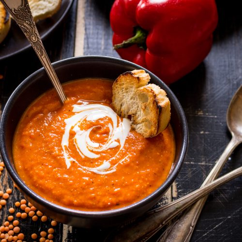 This Creamy Tomato Soup is perfect for those cool fall and winter evenings when you want to curl up with a good book, a tasty soup, and a warm fireplace. #tomatosoup #soup #fallsoup #manthatlooksgood